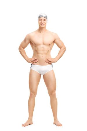 Foto de Full length portrait of a young handsome swimmer posing in white swim trunks isolated on white background - Imagen libre de derechos