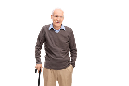 Foto de Senior man with a cane smiling and posing isolated on white background - Imagen libre de derechos