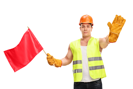 Photo pour Construction worker waving a red flag and making a stop hand gesture isolated on white background - image libre de droit
