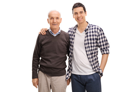 Photo pour Cheerful father and son hugging and posing together isolated on white background - image libre de droit
