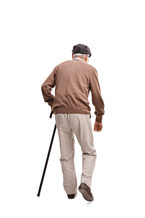 Photo pour Rear view vertical shot of an old man walking with a black cane isolated on white background - image libre de droit