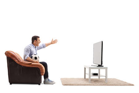 Angry man watching football on TV and shouting isolated on white background