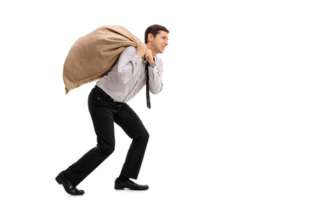 Photo for Full length profile shot of a businessman carrying a sack isolated on white background - Royalty Free Image