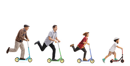 Foto de Senior, man, young man and a kid  riding scooters isolated on white background - Imagen libre de derechos