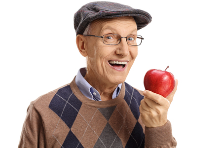 Foto per Cheerful senior having an apple isolated on white background - Immagine Royalty Free