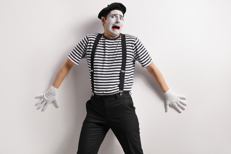 Photo for Terrified mime against a wall - Royalty Free Image