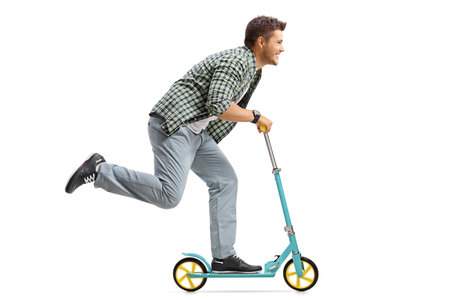 Photo for Profile shot of a young man riding a scooter isolated on white background - Royalty Free Image