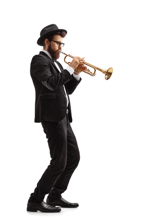 Photo for Full length profile shot of a trumpet player isolated on white background - Royalty Free Image