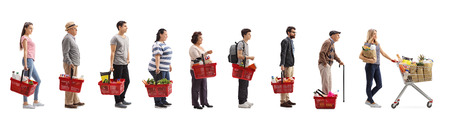 Foto de Full length profile shot of people with groceries waiting in line isolated on white background - Imagen libre de derechos
