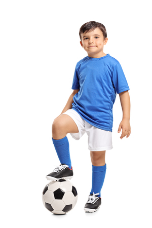 Foto de Full length portrait of a little footballer isolated on white background - Imagen libre de derechos