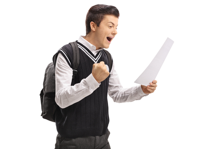 Foto de Teenage student looking at an exam and gesturing happiness isolated on white background - Imagen libre de derechos
