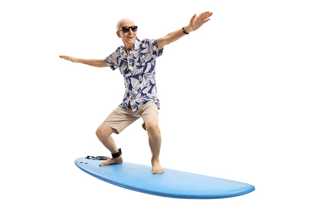 Photo pour Joyful elderly man surfing isolated on white background - image libre de droit