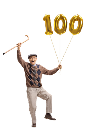 Photo for Full length portrait of an overjoyed senior with a cane and a golden number hundred balloon isolated on white background - Royalty Free Image
