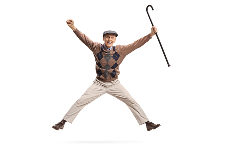 Photo for Full length portrait of an overjoyed senior with a cane jumping isolated on white background - Royalty Free Image