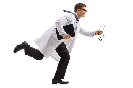 Foto per Full length profile shot of a doctor with a clipboard and a stethoscope running isolated on white background - Immagine Royalty Free