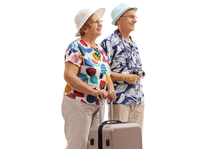 Photo pour Elderly tourists with a suitcase isolated on white background - image libre de droit
