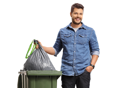 Photo for Young man taking out the garbage isolated on white background - Royalty Free Image