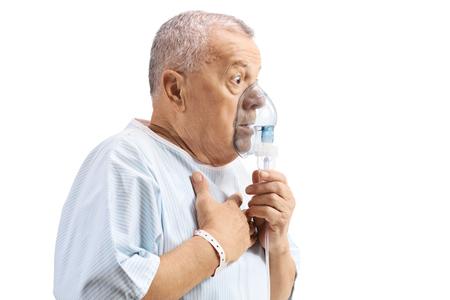 Photo pour Elderly patient using an inhalation mask - image libre de droit