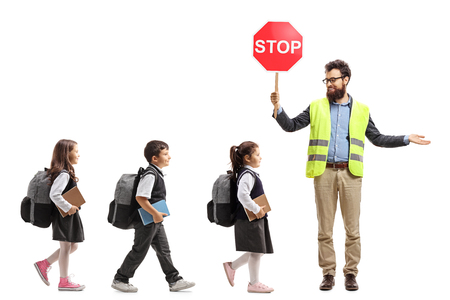 Photo for Full length shot of schoolchildren walking in a line and a teacher with a safety vest - Royalty Free Image