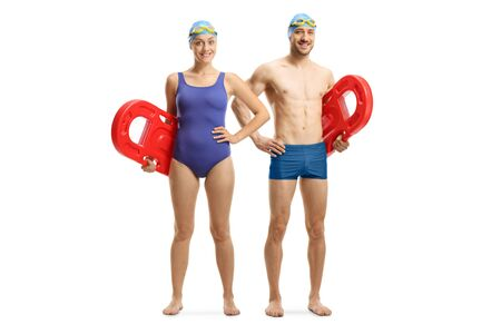 Photo for Full length portrait of a young man and woman in swimming suit holding swimming floats isolated on white background - Royalty Free Image