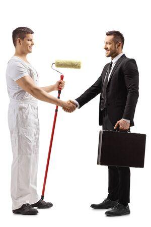 Foto de Full length profile shot of a painter shaking hands with a businessman isolated on white background - Imagen libre de derechos