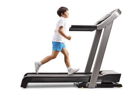 Foto per Full length profile shot of a boy running on a treadmill isolated on white background - Immagine Royalty Free