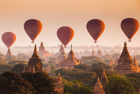 Photo for Hot air balloon over plain of Bagan in misty morning, Myanmar - Royalty Free Image