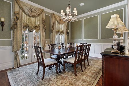 Dining room in luxury home with french doors