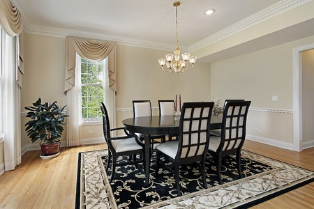 Dining room in suburban home with black table