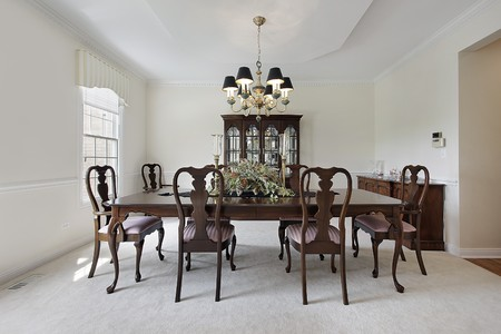 Traditional formal dining room with white carpeting