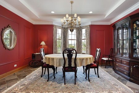 Dining room in luxury home with red walls