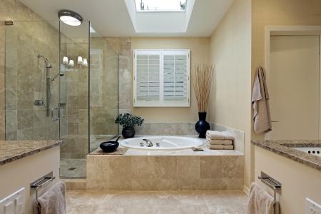Luxury master bath with skylight over bath tub