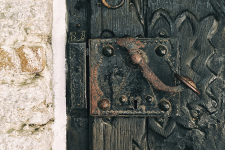Photo pour Architecture in the city. Part of old wooden door with iron hinges. An old door in the house. Vintage drawing on the door - image libre de droit