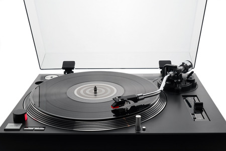 Foto de Turntable vinyl record player. Audio equipment for disc jockey. Sound technology for DJ to mix & play music. Black vinyl record. Bright background for the basic design - Imagen libre de derechos