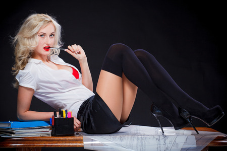 Photo pour sexy teacher girl on the table sitting - image libre de droit