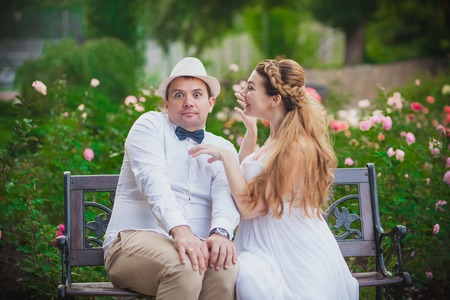 Photo for Bride and groom having fun in park - Royalty Free Image
