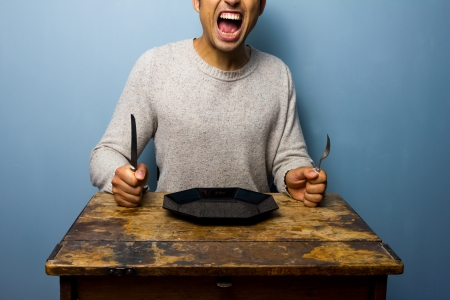 Photo pour Hungry man screaming for his dinner - image libre de droit