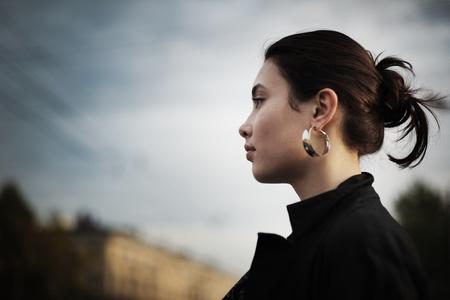 Portrait of stylish Asian woman in city, closeup.