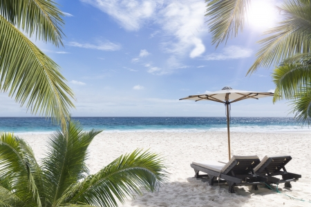 Beach chair at sunny coast. Seychelles. Mahe island.