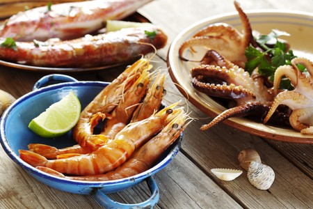 selection of seafood in a rustic setting