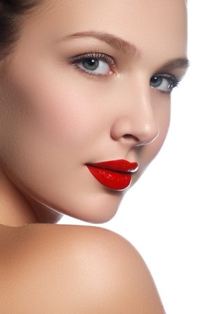 Photo pour Beauty model girl with perfect make-up isolated over white. Portrait of attractive young woman on white background. Beautiful female face with clear fresh skin. Red lips - image libre de droit