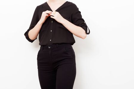 Foto de Hipster Model. Swag. Minimal style. Vintage Glamour. Fashionable model in a trendy silk shirt and black pants. Outfit red fashion stylish makeup lips. Trend - Imagen libre de derechos