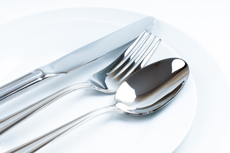 Photo for Shiny new cutlery, silverware close-up on white background - Royalty Free Image