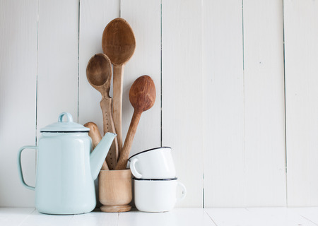 Photo pour Home kitchen still life: Vintage coffee pot, enamel mugs and antique rustic wooden spoons on a barn wall background, soft pastel colors. - image libre de droit