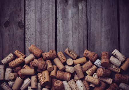 Photo for Lots of wine corks on old wooden board - Royalty Free Image