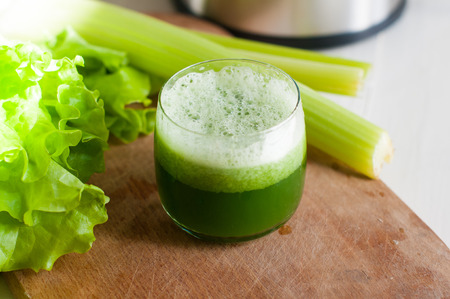 Photo for Freshly squeezed juice of fresh cucumber and celery, detox diet, vegan food - Royalty Free Image