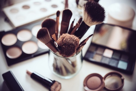 Photo for Professional makeup brushes and tools, natural make-up products set on white table. - Royalty Free Image