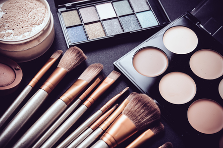 Photo pour Professional makeup brushes and tools collection, make-up products set on black  table background. - image libre de droit