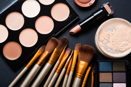 Foto de Professional makeup brushes and tools collection, make-up products set on black  table background. - Imagen libre de derechos