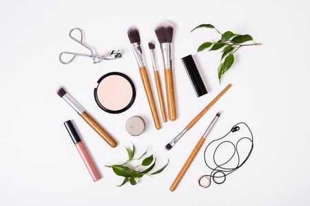 Foto de Professional makeup brushes and tools, make-up products kit, flatlay on white background - Imagen libre de derechos
